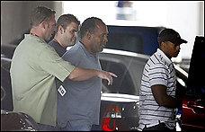 OJ Simpson in handcuffs